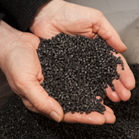 33433_33433_Image_Axpoly-black-granules-with-hands-PP-PS.jpg