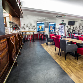 Cardiff Arms Park bar area featuring Polyflors Forest fx PUR vinyl flooring in Rustic Oak and Expona Design PUR luxury vinyl tiles in Atlantic Slate