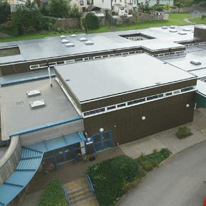 Eden Park Academy, showcasing its recent roof refurbishment with Sika Liquid Plastics' liquid waterproofing membrane, Decothane.