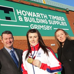 Howarth Timber's Mark Terry and Imogen Howarth with Hollie Arnold