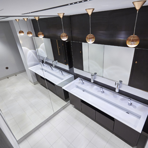 55 St James Street washroom featured 'copper' pendant lights