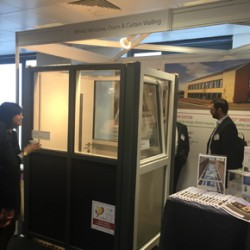 Delegates at the Passivhaus conference viewing the REHAU stand