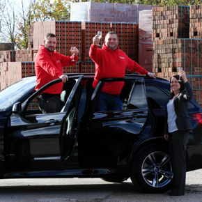 Paul Whitehead receiving his BMW X5 from Buildbase