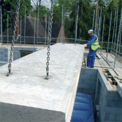 Pre-fabricated flooring being installed at a construction site