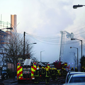 Firefighters work on a fire in a block of flats in Peckham on November 26, 2009 in London
