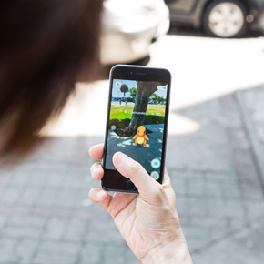 An ios user plays pokemon go, a free-to-play augmented reality mobile game developed by niantic for ios and android devices.