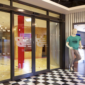 GEZE bi-parting automatic doors at the New Balance HQ