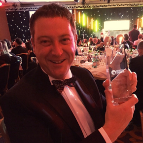 Anthony Owen collecting security excellence award