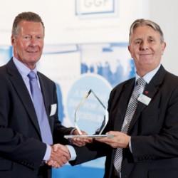 GGF Nigel Rees Presents Brian Baker Saint Gobain 350th Award