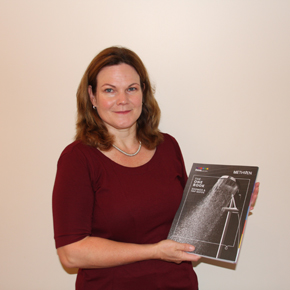 Methven's new Sales Manager Rachael Gray, holding its One Book brochure