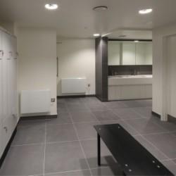 Washroom staff shower and changing facilities featuring bespoke locker design