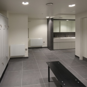 Washroom staff shower and changing facilities featuring bespoke locker design