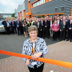 Schlüter's co-founder cutting the ribbon at the opening of the new SSEC facility